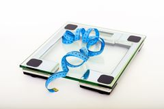 Blue Tape Measuring on Clear Glass Square Weighing Scale Stock Photography