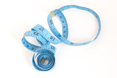 Blue tape measuring on a white Royalty Free Stock Photos