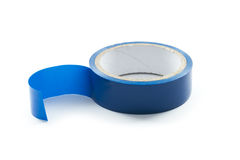 Blue tape. Roll of blue sticky tape isolated on white background Stock Photos