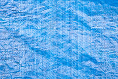 Blue tarpaulin. Close up of a blue tarpaulin as a background image Royalty Free Stock Image