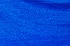 Blue tarpaulins fabric texture. Blue tarpaulins surface, tarpaulins texture material is from plastic, wavy and wrinkle tarpaulins Stock Photo