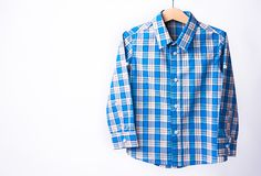 Blue tartan shirt folded on white background. Blue tartan shirt folded on white background Royalty Free Stock Photos
