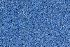 Blue tartan track texture background. Blue tartan athletic running track texture on the stadium. Tartan track material is the trademarked all-weather synthetic Stock Image