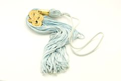 Blue Tassel. A macro shot of a blue tassel over a white background Royalty Free Stock Photography
