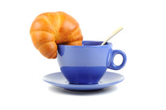 Blue  tea cup and croissant Royalty Free Stock Images
