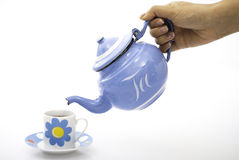 Blue tea cup and kettle Stock Images