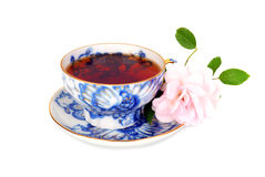 Blue tea cup and pink rose Royalty Free Stock Image