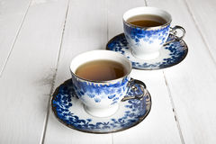 Blue tea cups in white. Wooden table Royalty Free Stock Photos