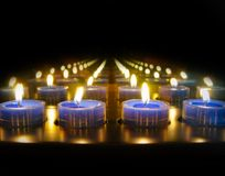 Blue tea lights burning royalty free stock photography