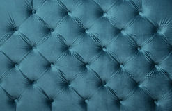 Blue teal capitone tufted fabric upholstery texture Royalty Free Stock Photos