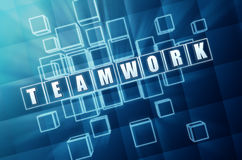 Blue teamwork in glass blocks Stock Photos