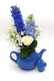 Blue teapot with bouquet. Of healing herbs and flowers Stock Photo