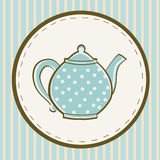 Blue teapot with dots on colored  background Royalty Free Stock Images