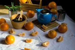 Blue teapot,  tea and mandarin Royalty Free Stock Images