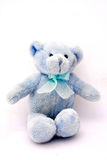 Blue teddy bear. A little light blue dirty teddy bear toy for kids with open arms. Image isolated on white studio background Stock Image