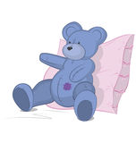 Blue Teddy bear on pink pillow Royalty Free Stock Images