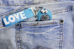 Blue Teddy bear in the pocket of my jeans. royalty free stock images