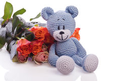 Blue teddy bear with roses Stock Photography