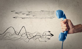 Blue telephone with doodles Stock Image