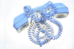 Blue telephone handset with cord Royalty Free Stock Photo