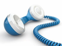 Blue telephone receiver. Stock Image