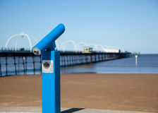 Blue telescope by blurred Southport pier Stock Photo