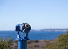 Blue telescope on coast of Malibu Stock Image