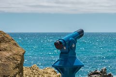 Blue telescope - panoramic binoculars for tourists with sea view royalty free stock photography