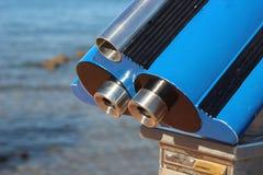 Blue telescope. On sea background Stock Photography