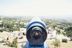 Blue telescope in a white village of Andalusia, Spain. Vintage tone. Royalty Free Stock Photos