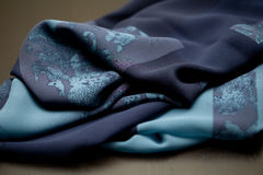 Blue tender colored textile, elegance rippled material Royalty Free Stock Images