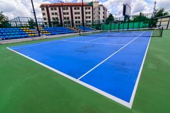 Blue tennis court with  lines Royalty Free Stock Photo