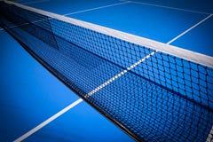 Blue tennis court. Net on blue tennis court sport background Royalty Free Stock Photo