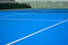 Blue tennis court Stock Images