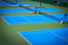 Blue tennis court. Sport background Stock Images