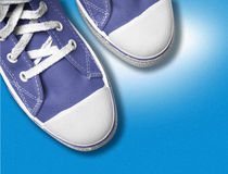 Blue tennis shoes. Close-up of blue tennis shoes Stock Photography