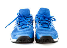 Blue tennis shoes on white backgound. Blue tennis shoes on white background front view royalty free stock photos