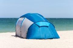 Blue tent at the Black Sea beach, Romania, Europe Royalty Free Stock Photo