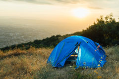 Blue tent on a hill near city Royalty Free Stock Photo