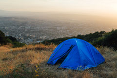 Blue tent on a hill near city Royalty Free Stock Photos