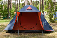 Blue tent with red entrance. Nature in the forest Stock Photo