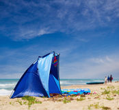 Blue tent at the sea Stock Images