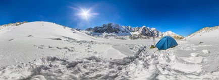 Blue tent in the snowy peaks of the mountains. cylindrical 360 panorama Royalty Free Stock Photos