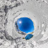 Blue tent in the snowy peaks of the mountains. A spherical 360 180 panorama of a little planet Stock Images