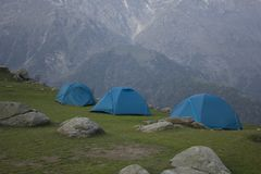 Tents camp in the mountains. Blue tents camp in the mountains royalty free stock photo