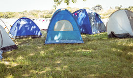 Blue tents in the campsite royalty free stock photography