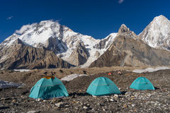 Blue tents at Concordia camp in front of Broadpeak mountain, K2. Trek, Pakistan, travel Asia Royalty Free Stock Image