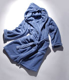 Blue terry bathrobe Stock Images