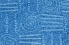 Blue terry towel with geometrical and spiral pattern Stock Photo