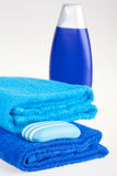 Blue terry towels, shampoo and soap Royalty Free Stock Photography